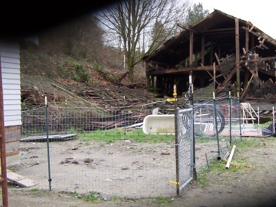 The old dog potty yard, in 2007, with a lot of fallen-down-barn waste and constructiond debris in the background.
